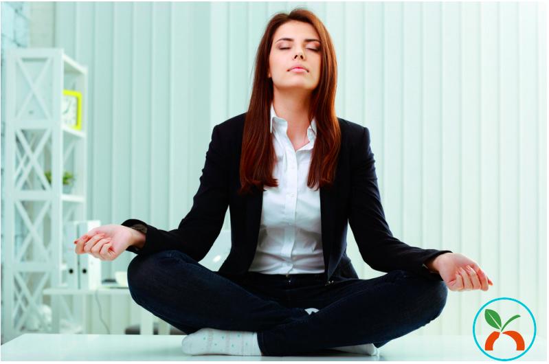 Business woman doing meditation