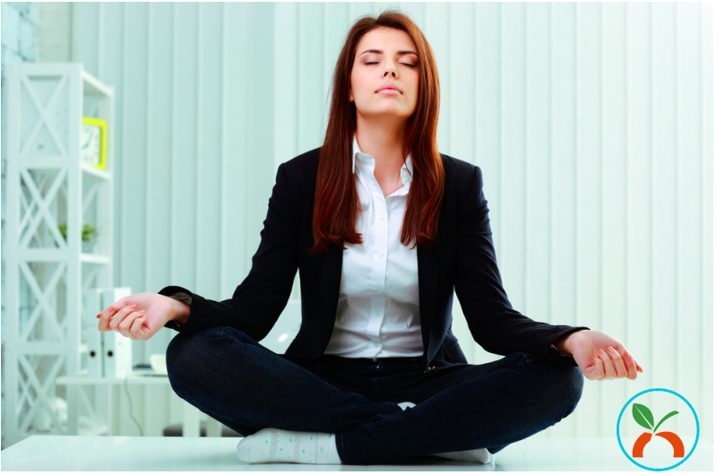 Business woman doing meditation